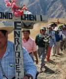 Carlos Chen Osorio leads a procession to remember victims of the Chixoy Dam massacres.