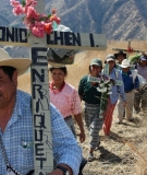 Carlos Chen Osorio, who lost his wife and two toddler daughters in the massacre, leads the row during the Via Crucis