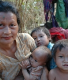 A Karen displaced family fleeing armed conflict in a temporary shelter on the bank of the Salween River, near a proposed dam site on the Salween