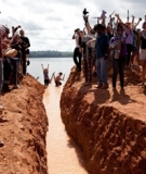 Activists restore the Xingu's natural flow at the Belo Monte Dam Site