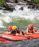 A Ugandan guide takes tourist through rapids on the Nile in Uganda. Locals are benefitting from jobs in the rafting industry