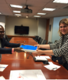 Jean-Marie delivering community petition to World Bank manager
