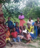 A woman addresses her fellow villagers in Inga.