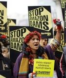 Almir Narayamoga Surui and Sheyla Yakarepi at protest outside BNDES office in London