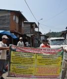 Men holding protest sign