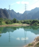Power lines cross the Hinboun River to bring electricity to Thailand.