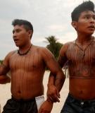 Members of the Munduruku indigenous tribe dance along the Tapajós river during a 'Caravan of Resistance' protest in November.