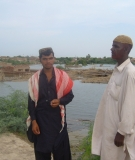 Affected people with their houses plunged under the flood waters