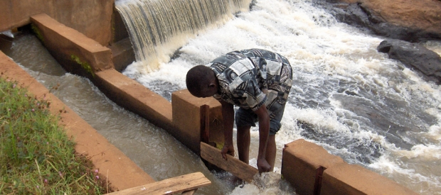 Opening the sluice gate on a small hydro project.