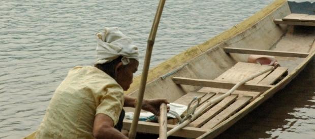 Khmu Elder Rowing Boat Along the Nam Ou