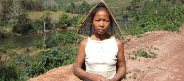 A villager on the Nam Tha River, which CSG plans to dam