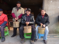 Men carrying warming baskets.
