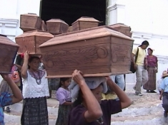 A mock funeral procession for Chixoy's dead.